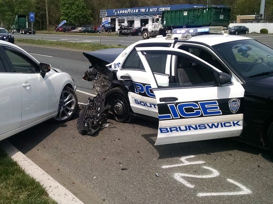 A South Brunswick police officer was injured when his vehicle was rear-ended during a motor vehicle stop on Route 130 on Monday.