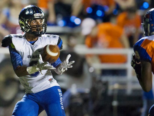 Ida Baker High School's Josh Nina scores a touchdown against Cape Coral during second quarter play Friday at Cape Coral High School in Fort Myers.