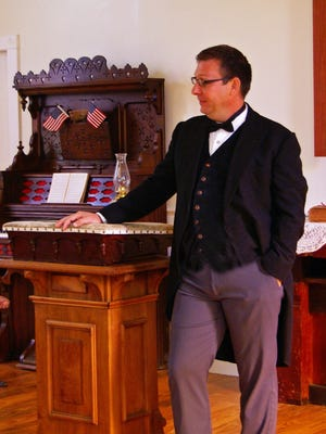 Pictured is Jim Riley in the church at the Miller Farm property at this year's Heritage Festival.
