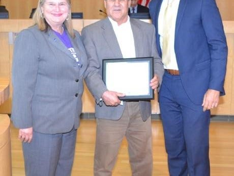 Rudy Guevara (center) stands with San Jose's Vice Mayor Rose Herrera (left) and Mayor Sam Liccardo (right) after he's presented with a commendation for his contributions to teaching and coaching on June 2.
