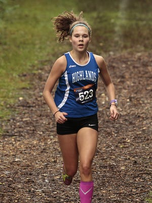 "Chloe Gastright of Highlands crests the top of ""mulch hill"".  The 2015 Mason Invitational cross country meet was held Saturday, September 12th at Corwin Nixon Park in Mason."