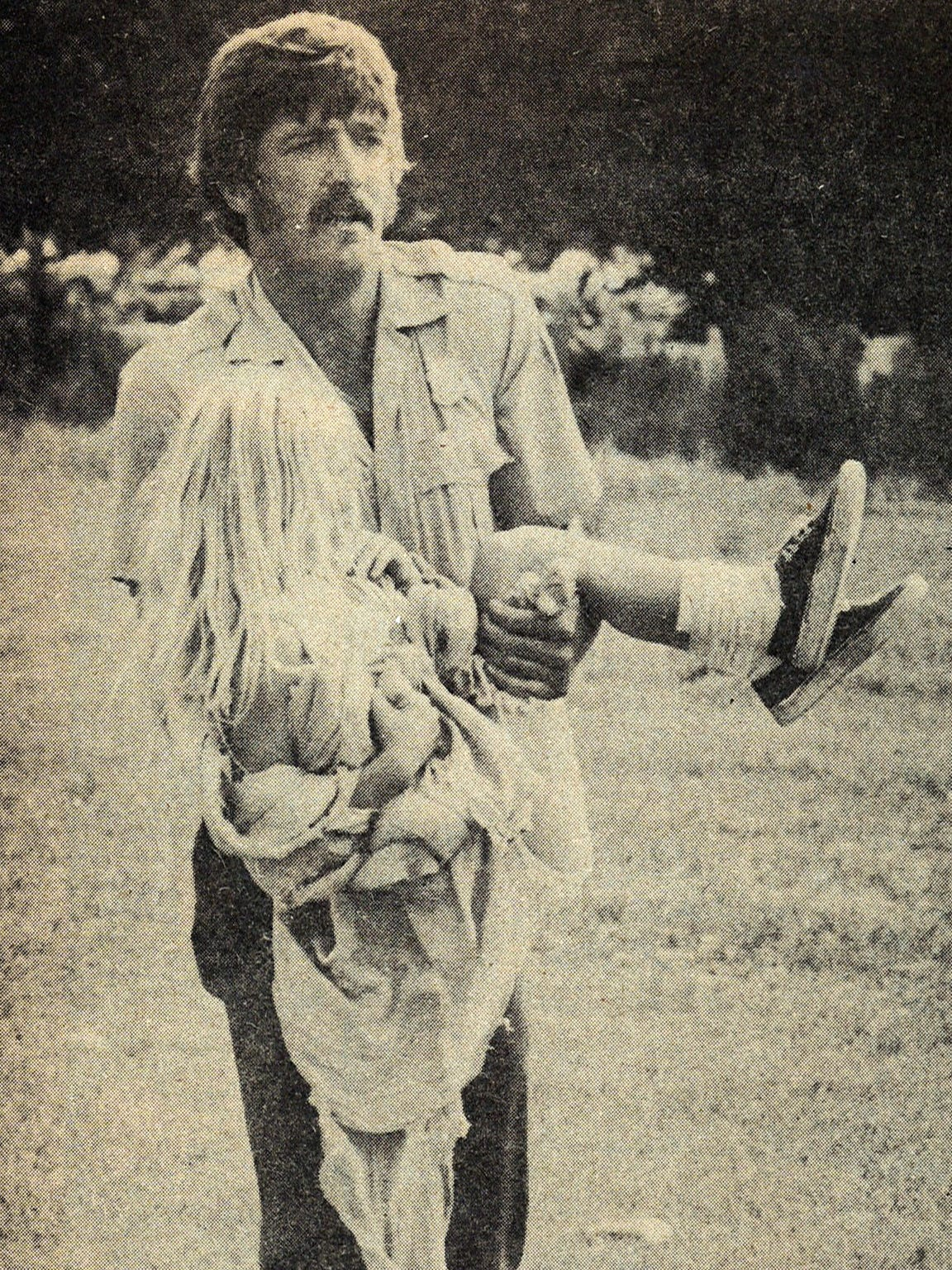 A volunteer carries a young girl to an aid station in the aftermath of the July 31, 1976 Big Thompson Flood.