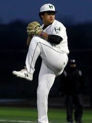 Iowa Park's Chris Dickens pitches against Vernon Tuesday,