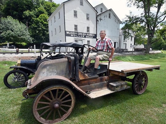 Robert L. Lefever of Peach Bottom Township shows his running 1918 International truck during Early American Auto Day on Sunday at the Ma & Pa Railroad Heritage Village at Muddy Creek Forks.