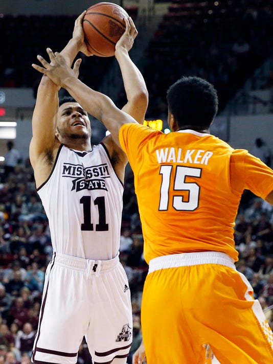 Mississippi State guard Quinndary Weatherspoon (11) shoots in front of Tennessee forward Derrick Walker (15) during the second half of an NCAA college basketball game in Starkville, Miss., Tuesday, Feb. 27, 2018. Tennessee won 76-54. (AP Photo/Rogelio V. Solis)