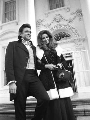 Singers Johnny Cash and wife June Carter Cash leave the north portico of the White House after a practice session for the performance tonight for President Nixon, April 17, 1970.