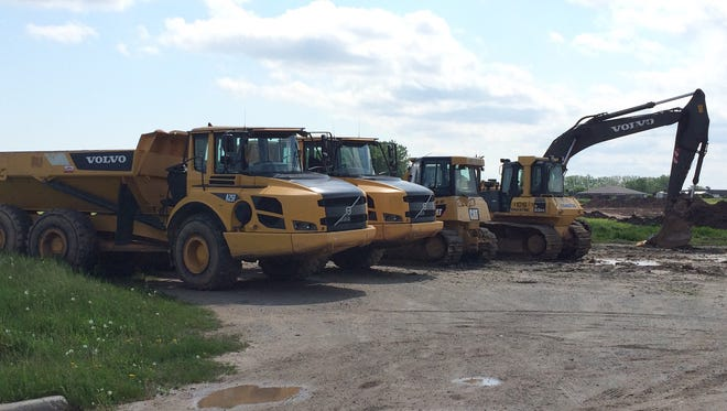 Trucks arrive, ready to start work on utilities and roads at the site of the future Costco Wholesale in Grand Chute.