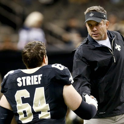 Oct 27, 2013; New Orleans, LA, USA; New Orleans Saints head coach Sean Payton shakes hands with tackle Zach Strief (64) prior to a game against the Buffalo Bills at Mercedes-Benz Superdome.