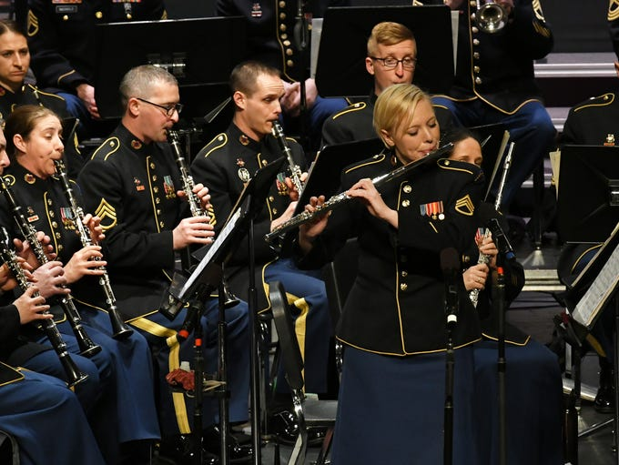 Staff Sgt. Pamela Daniels plays the flute with the