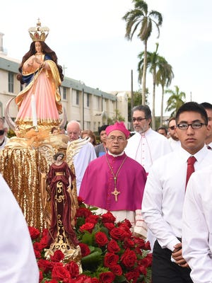 Archbishop Anthony Apuron, in magenta, is surrounded by clergy and parishioners during the annual Santa Marian Kamalen procession in Hagåtña on Dec. 8, 2015.