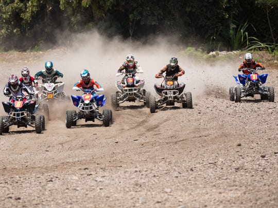 In this file photo, racers go through the first holeshot