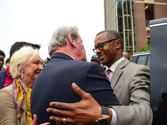 Florida State's new head coach Willie Taggart greets