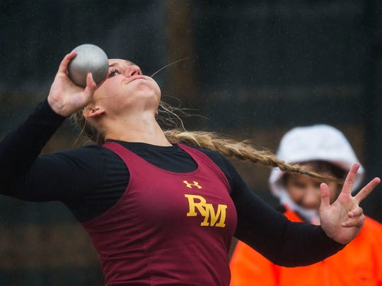 Rocky Mountain High School senior Gabi McDonald throws