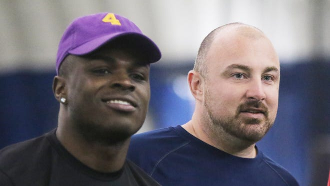Former Paramus Catholic football player Jabrill Peppers, left, and his former coach, Chris Partridge, attend the Youth Pro Level Football Camp for fourth- through eighth-graders in Waldwick, N.J., on April 9, 2016.