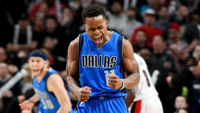 Dallas Mavericks guard Yogi Ferrell celebrates after hitting a shot late in the fourth quarter of the game against the Portland Trail Blazers at the Moda Center. Dallas won the game 108-104.