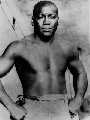 "This undated photo shows boxer Jack Johnson, whom President Donald Trump says he's considering a full pardon for boxing's first black heavyweight champion more than 100 years after Jack Johnson was convicted by all-white jury of ""immorality"" for one of his relationships."