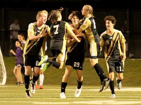 The Rider Raides celebrate a goal against Birdville in the Region I-5A area playoff Friday, March 31, 2017, in the Birdville ISD Fine Arts and Athletic Complex in North Richland Hills. The Raiders lost 3-1 to Birdville.