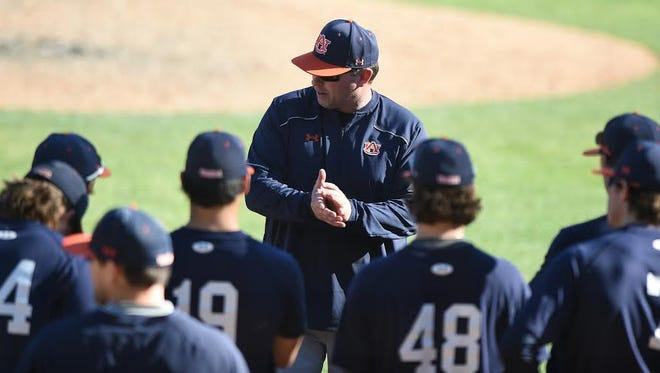 New Auburn coach Butch Thompson speaking to his players before practice on Saturday, Jan. 30. Auburn conducted its fist set of three scrimmages last weekend.