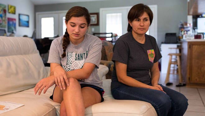 Erin Werner, shown with mom Marisa Werner, says she will return to Santa Fe High School when classes resume.