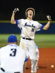 Mountain Home's Masen Walker clebreates hitting a two-run
