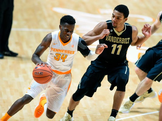Tennessee guard Devon Baulkman (34) tries to drive to the hoop as Vanderbilt forward Jeff Roberson (11) defends during the first half of an NCAA college basketball game against Vanderbilt at Thompson-Boling Arena on Wednesday, Jan. 20, 2016 in Knoxville, Tenn. (Adam Lau/Knoxville News Sentinel via AP) MANDATORY CREDIT