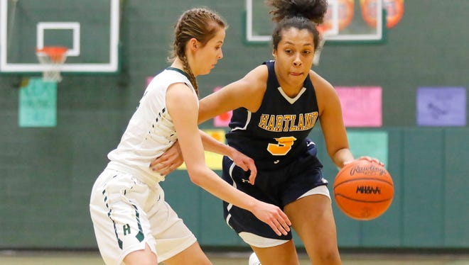 Hartland's Graysen Cockerham (3), who had a game-high 20 points, is guarded by Alexis Miller, who led Howell with 16.