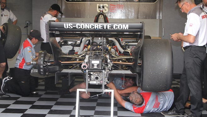 The crew for Marco Andretti (98) car works on his engine during the morning practice for the IndyCar Grand Prix at the Indianapolis Motor Speedway on Saturday, May 12, 2018.
