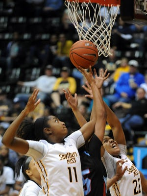 Southern Miss' Voché Martin (11) and Megan Brown (22) fight for an offensive rebound during last week's game against Louisiana Tech.