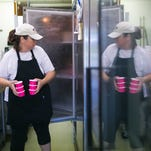 Blotto Gelato owner Kathleen Belfont pours a batch of chocolate raspberry kiss gelato which has alcohol in it.