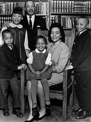 This 1966 file photo is the last official portrait taken of Dr. Martin Luther King Jr.'s entire family. In the study of Ebenezer Baptist Church in Atlanta are, from left, Dexter King, Yolanda King, Martin Luther King Jr., Bernice King, Coretta Scott King and Martin Luther King III.  A judge in Atlanta signed an order Wednesday, Jan. 28, 2015, halting action in a legal dispute that pits King's two sons against his daughter Bernice over ownership of his most cherished items.