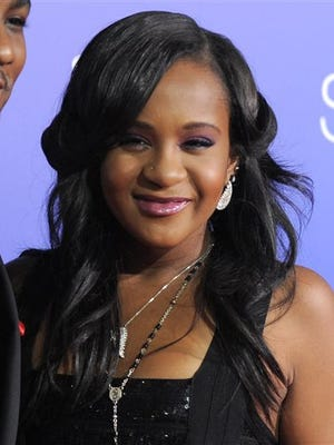 """In this Aug. 16, 2012 file photo, Bobbi Kristina Brown attends the Los Angeles premiere of """"Sparkle"""" at Grauman's Chinese Theatre in Los Angeles. The daughter of late singer and entertainer Whitney Houston was found Saturday, Jan. 31, 2015, unresponsive in a bathtub by her husband and a friend and taken to an Atlanta-area hospital. The incident remains under investigation."""