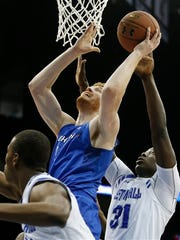 Creighton center Geoffrey Groselle, goes up for a shot against Seton Hall guard Isaiah Whitehead, left, and Seton Hall forward Angel Delgado.