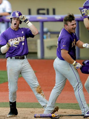 LSU infielder Greg Deichmann (7), left, celebrates after hitting a two run home run against Rice in the seventh inning of an NCAA college baseball tournament regional game in Baton Rouge.