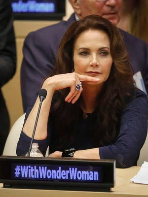 """FILE - In this Oct. 21, 2016 file photo, Lynda Carter, who played Wonder Woman on television, listens during a U.N. meeting to designate Wonder Woman as an """"Honorary Ambassador for the Empowerment of Women and Girls,""""  at U.N. headquarters.  Rhéal LeBlanc, the head of press and external relations, said Tuesday, Dec. 13,  the appointment of Wonder Woman as an Honorary Ambassador for the Empowerment of Woman and Girls would end this week, a move that come less than two months after a splashy ceremony at the U.N."""