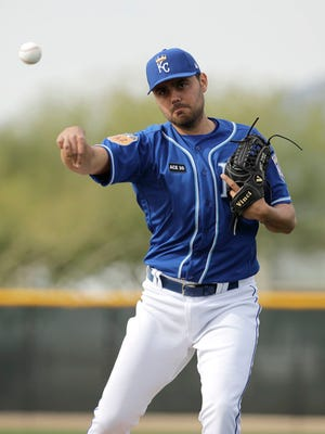 This photo taken Feb. 14, 2017, shows Kansas City Royals pitcher Joakim Soria throwing during spring training baseball practice, in Surprise, Ariz. Soria shouldn't have any issue with confidence, not with 202 career saves. Yet when he returned to Kansas City last season, armed with a $25 million, three-year deal to serve as the primary setup man for closer Wade Davis, his confidence appeared to be precisely the problem.