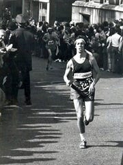 In this April 16, 1973, photo provided by Joyce Heard, Ben Beach, age 23, runs along the Boston Marathon course. Beach, of Bethesda, Md., is looking to be the first person to run the race 50 years in a row on Monday, April 17, 2017.