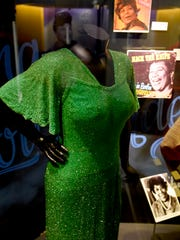 """A dress worn by Ella Fitzgerald is displayed at a sneak preview of """"Ella at 100: Celebrating the Artistry of Ella Fitzgerald"""" at The Grammy Museum at L.A. Live on Monday, April 24, 2017, in Los Angeles."""