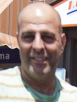 FILE - This photo taken July 5, 2016, shows Amer Fakhoury, owner of Little Lebanon To Go restaurant in Dover, N.H. Fakhoury, an American who was jailed for months in Lebanon and later released over decades-old murder and torture charges that he denied, died Monday,  Aug. 17, 2020, his family said. He was 57. Fakhoury, a restaurant owner in Dover, New Hampshire, died at the Dana-Farber Cancer Institute in Boston. He had been diagnosed with State 4 lymphoma while in prison.