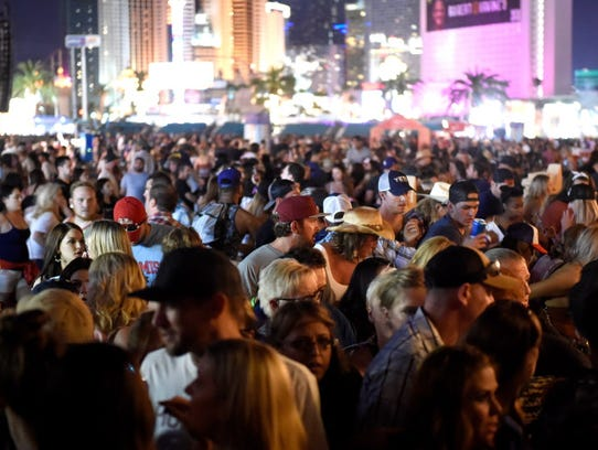 Throngs of people move away from the Route 91 Harvest