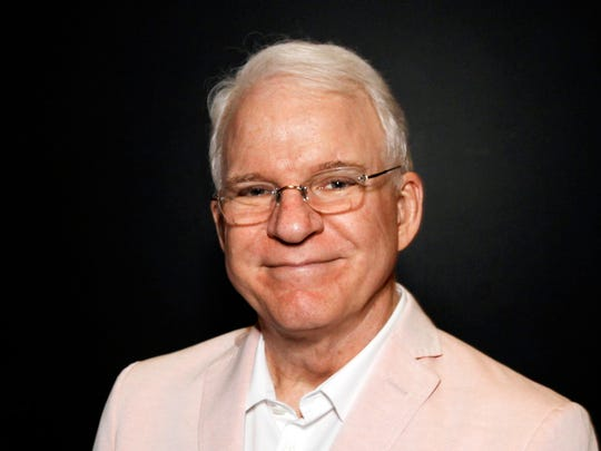 """In this June 23, 2014 file photo, Steve Martin poses during """"The Un-Private Collection: Eric Fischl and Steve Martin,"""" an art talk presented by The Broad museum in Santa Monica, Calif."""