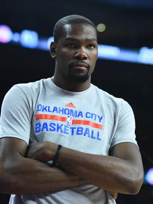 Mar 29, 2016; Auburn Hills, MI, USA; Oklahoma City Thunder forward Kevin Durant (35) watches from the bench during the fourth quarter against the Detroit Pistons at The Palace of Auburn Hills. Mandatory Credit: Tim Fuller-USA TODAY Sports