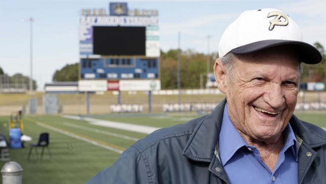Ray Rogers, long-time Pearl High football announcer, smiles as he talks about fond memories at Ray Rogers Stadium on Tuesday.