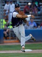 East Cobb third baseman Devin Warner throws to first