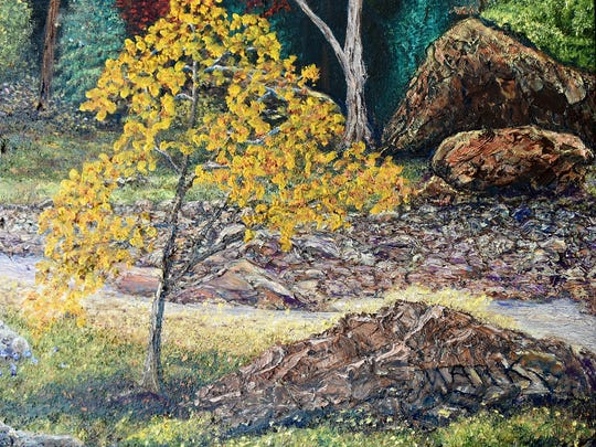 Johnstown artist Mark Nelson tries to hide his signature, blending it in to elements within his paintings, such as a stone along a creek bed.