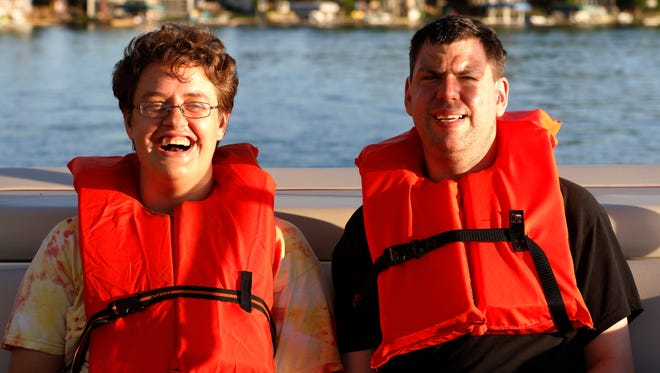 Association for the Developmentally Disabled of Manitowoc County summer campers Becky Kummer, left, and Adam Meyer enjoy the boat ride on Pigeon Lake during the sunset hours on Tuesday, July 26 in Valders. The ADD moved the camp to Camp Sinawa three years ago and the campers like the location very much.