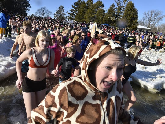 Organizers of annual New Year's Day plunge drew between 800-900 jumpers last year representing 22 states and two foreign countries — France and Canada. In addition, the jump was witnessed by 2,000 spectators at Lakeside Park. It is hosted by the Jacksonport Polar Bear Club.