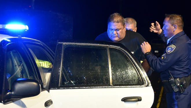 Christopher Brian Rayphand, 48, who was driving a Dodge Dakota involved in an auto-pedestrian accident in Harmon late Saturday, is arrested at the scene. He failed a field sobriety test, according to police.