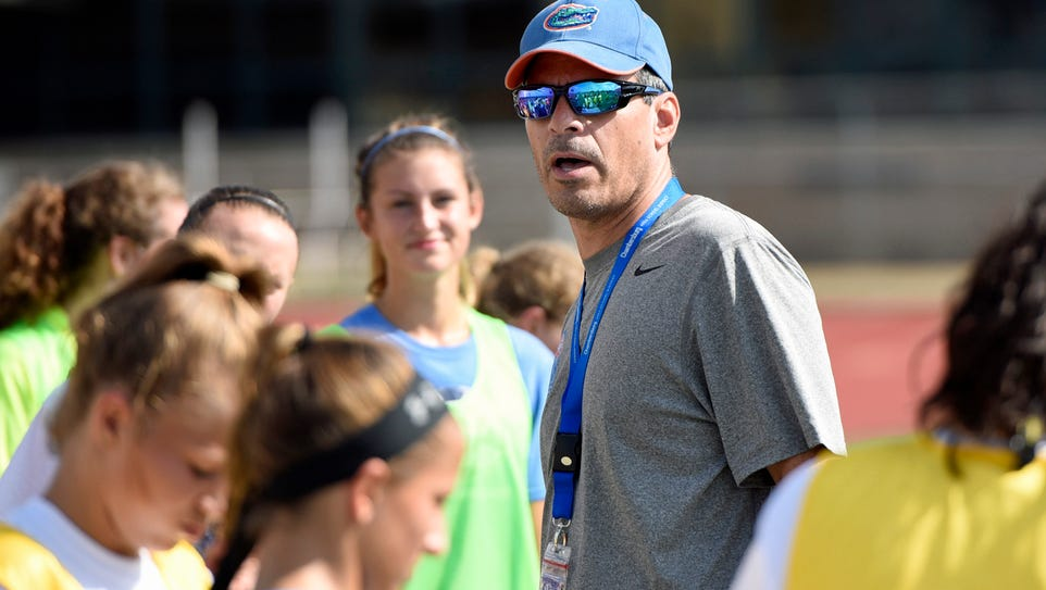 Ed Franchi, center, is now the girls soccer coach at