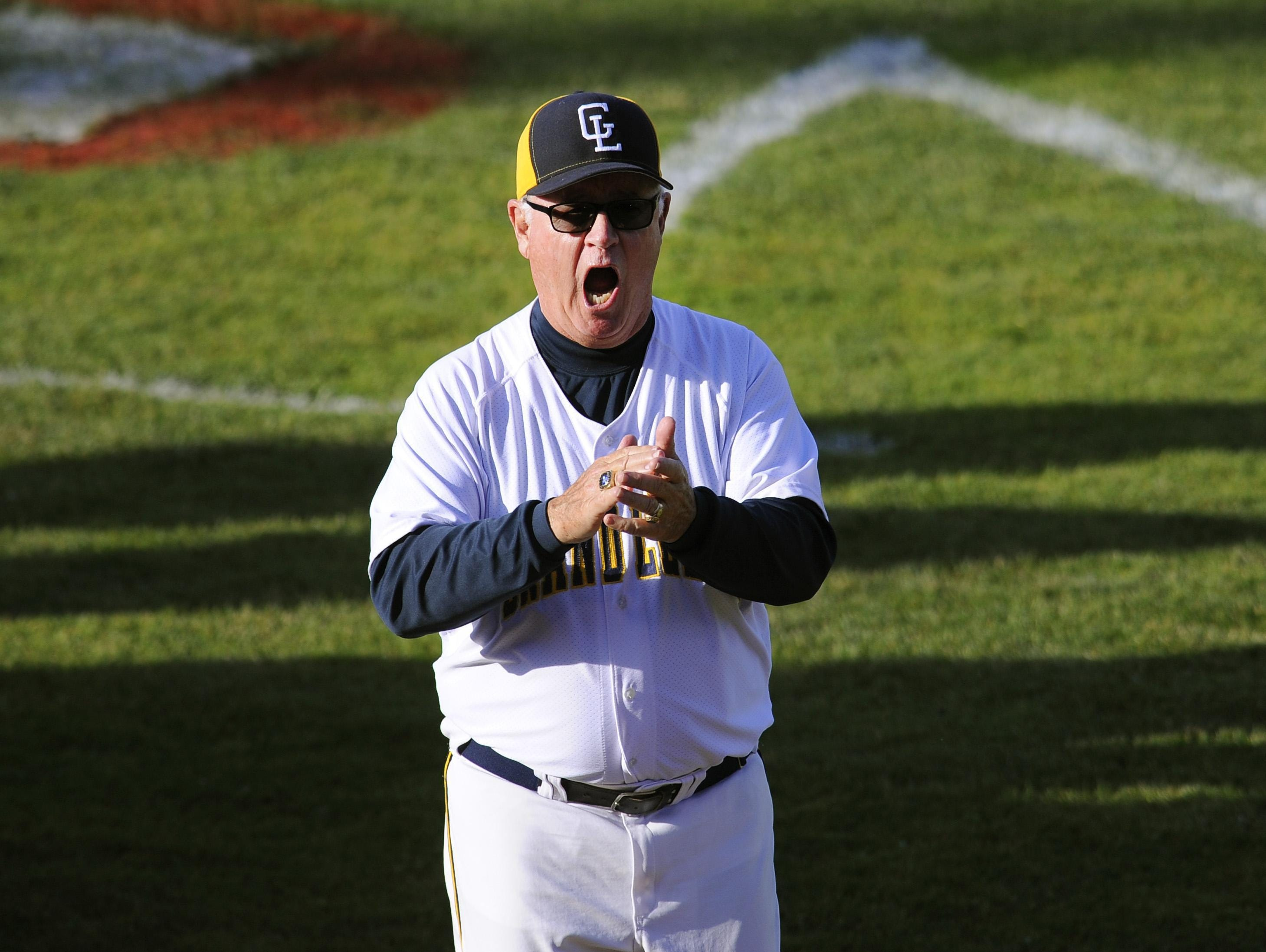 """Grand Ledge's Pat O'Keefe, 70, had 1,203 career wins entering Thursday's doubleheader against Okemos. """"I still like dressing up and acting like a kid,"""" he said."""