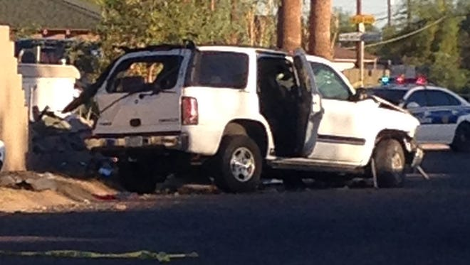 A handcuffed teenage girl drove a car while evading arrest when she allegedly crashed into a wall in West Phoenix, resulting in critical injuries for two young boys who were not properly restrained, police said.